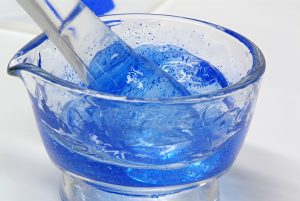 Glass mortar and pestle with blue gel