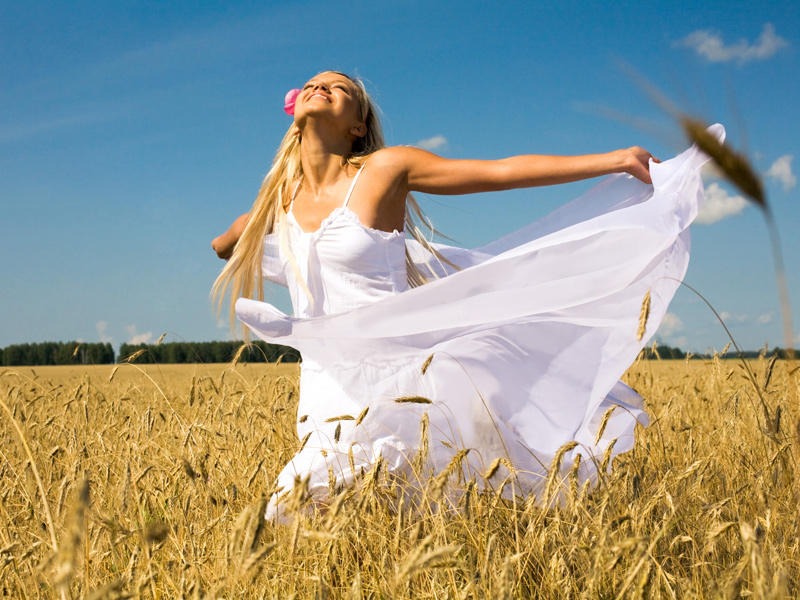 lady with freedom in grass