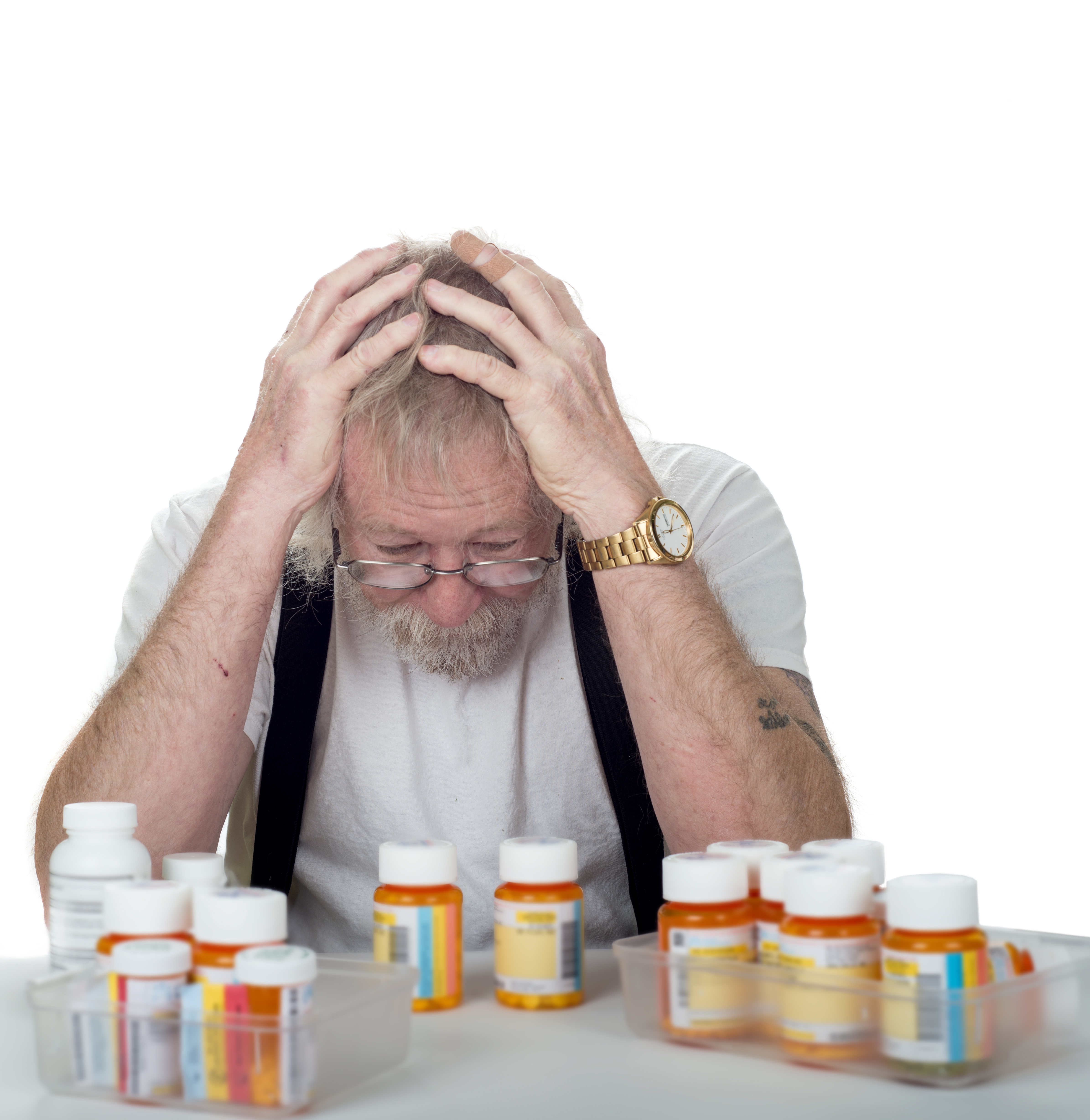 Confused Man with lots of medicines